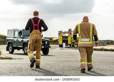 Military Airbase Fire Fighters Tackling Extinguising Burning Inferno - Teamwork against Natural Disaster