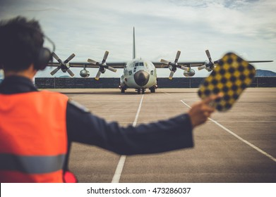 Military aircraft c130 , ship parked in the airport ready to fly.
