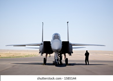 military aircraft - F-15 strike eagle on tarmac with pilot and technician