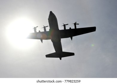 military aircraft hercules at the sky