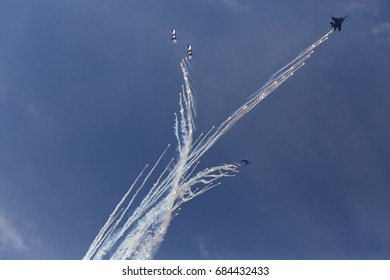 Military aircrafts making a stunt with fireworks. Russia, Moscow Airshow in July 2017