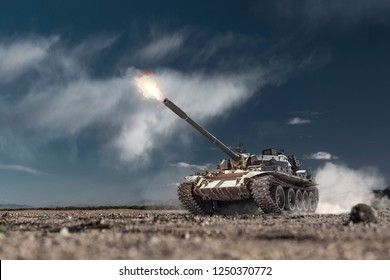 Military or army battle tank firing in the desert war ground. Fire bursting from the gun barrel of the tanks turret