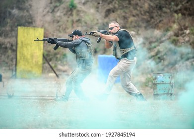 Military army soldiers in action tactical combat shooting from rifle machine gun. Shooting and weapons. Outdoor shooting range