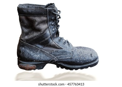 Military boots and dusty on the white background.