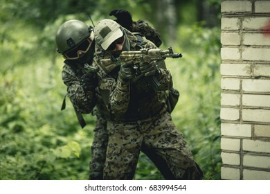 Military in camouflage with gun