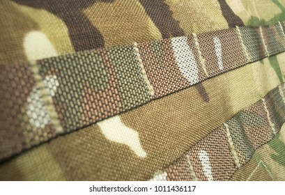 Military camouflage webbing material on a British army rucksack / backpack. Potential use as a background.