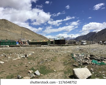 A military camp in the middle of the valley at Leh Ladakh. The sky is full of white clouds behind.