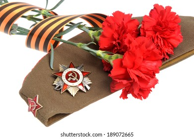 Military cap, order of Great Patriotic war, red flowers, Saint George ribbon isolated