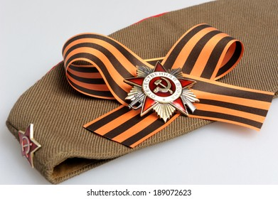 Military cap with Saint George ribbon and order of Great Patriotic war on gray