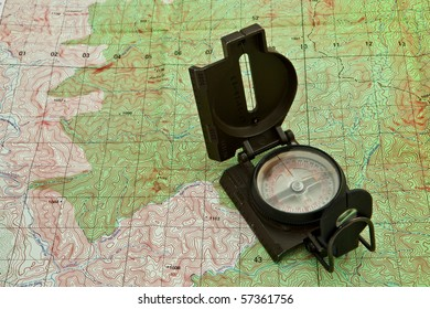 A military compass on a military map.