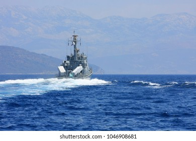 Military cruiser heading away on Adriatic sea