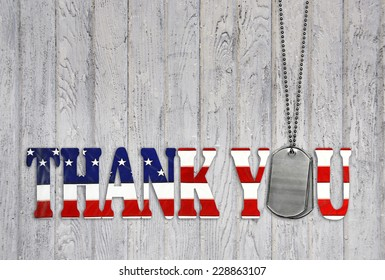 military dog tag thank you with flag font on weathered barn wood background