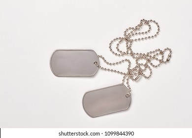 Military dog tags isolated on white background. Blank army dogtags with copyspace.