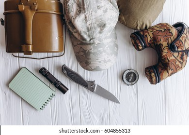 Military equipment on white wooden background