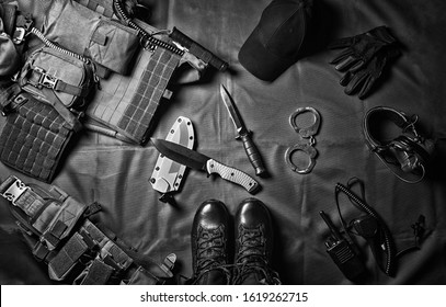 Military equipment or special agent gear concept flat lay background with copy space. Mixed media