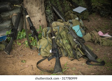 Military equipment, weapons , ammunition, backpacks , hats , military shelters , a military camouflage mesh texture picture day border war sandbag bunkers on the mountain .