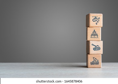 Military equipment wooden block icons on with grey background copy space - Army war battle conflict weapons of tank aircraft missile and destroyer - Navy, airforce and armed special forces concept
