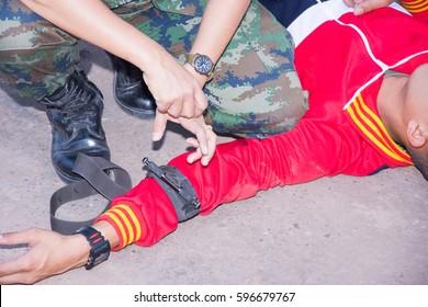 military explain technique use tourniquet stop bleed