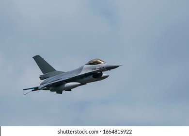 Military F16 fighter jet close up flying through the air. Royal Netherlands Air Force F16 fighter jet aircraft taking off. Jet F-16 fly in the sky.