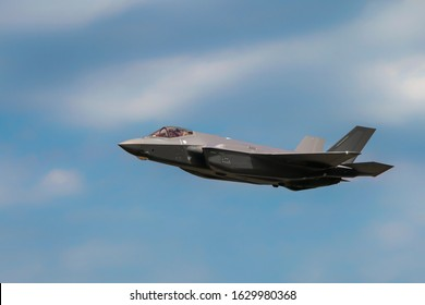 "Military F35 fighter jet flying. Blue sky with clouds. Lockheed Martin F-35B ""Lightning"" II"