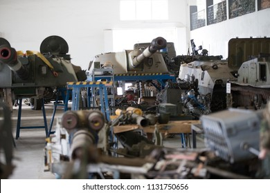 Military factory.Warehouse of military equipment. Battle tanks in the factory
