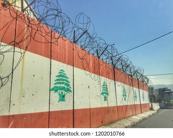 Military fence with Lebanese flag and barbed wire in Beirut, Lebanon