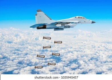 Military fighter aircraft flying drops bombs from a great height. Military operation bombing.