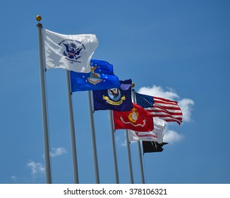 Military Flags Flying Proudly in a Clear Blue Sky