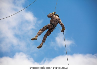 Military force is practicing rappel