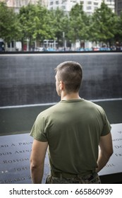 Military Freedom Run: A U.S. Marine looks to the reflecting pool of the World Trade Center Towers site after the Freedom Run to the National September 11 Memorial site Fleet Week, NEW YORK MAY 26 2017