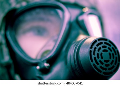 Military gas mask closeup with focus on the respirator.