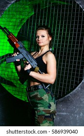 Military girl with gun