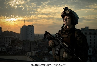 Military girl in uniform of the U.S. Army looks into the distance. Hostilities.