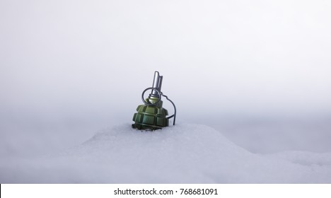 military grenade in the snow