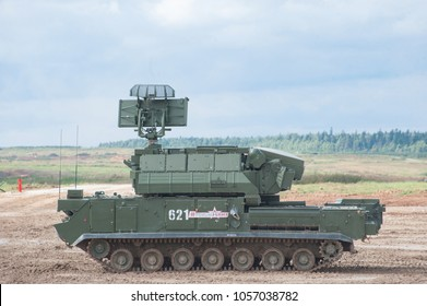 """MILITARY GROUND ALABINO, MOSCOW OBLAST, RUSSIA - Aug 24, 2017:  Russian tactical air defense missile system """"Tor"""" (SA-15 Gauntlet) at the International military-technical forum ARMY-2017, side view"""