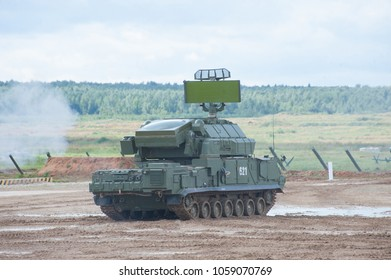 """MILITARY GROUND ALABINO, MOSCOW OBLAST, RUSSIA - Aug 24, 2017:  Russian tactical air defense missile system """"Tor"""" (SA-15 Gauntlet) at the International military-technical forum ARMY-2017, rear view"""