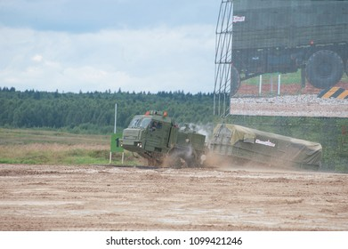 """MILITARY GROUND ALABINO, MOSCOW OBLAST, RUSSIA - Aug 24, 2017: Russian military truck BAZ-6402 """"Voschina"""" leaves the pool at the site of Alabino, the international military forum ARMY-2017, side view"""