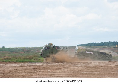 MILITARY GROUND ALABINO, MOSCOW OBLAST, RUSSIA - Aug 24, 2017: Russian military truck BAZ-6402 passes artificial pond at the site of Alabino, international military-technical forum ARMY-2017,side view