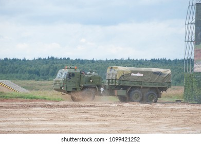 MILITARY GROUND ALABINO, MOSCOW OBLAST, RUSSIA - Aug 24, 2017: Russian military cargo vehicle BAZ-6402 moving on the landfill Alabino, international military-technical forum ARMY-2017, side view