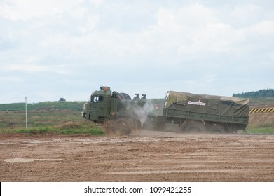 MILITARY GROUND ALABINO, MOSCOW OBLAST, RUSSIA - Aug 24, 2017: Russian military truck BAZ-6402 passes artificial pond at the site of Alabino, international military-technical forum ARMY-2017