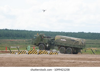 MILITARY GROUND ALABINO, MOSCOW OBLAST, RUSSIA - Aug 24, 2017: Russian military truck BAZ-6402 overcomes an obstacle at the site of Alabino, the international military-technical forum ARMY-2017