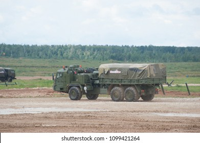 MILITARY GROUND ALABINO, MOSCOW OBLAST, RUSSIA - Aug 24, 2017: Russian military cargo vehicle BAZ-6402 high cross-country moving the landfill Alabino, international military-technical forum ARMY-2017