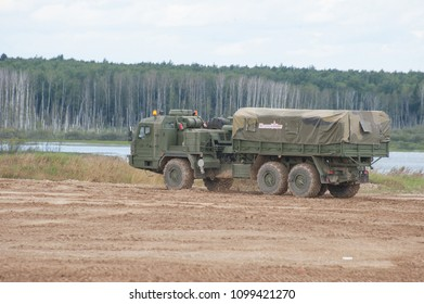 MILITARY GROUND ALABINO, MOSCOW OBLAST, RUSSIA - Aug 24, 2017: Russian military truck BAZ-6402 high cross-country moving landfill Alabino, international military-technical forum ARMY-2017, side view