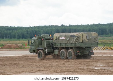MILITARY GROUND ALABINO, MOSCOW OBLAST, RUSSIA - Aug 24, 2017: Russian military truck BAZ-6402 cross-country rides at the site of Alabino, international military-technical forum ARMY-2017, rear view