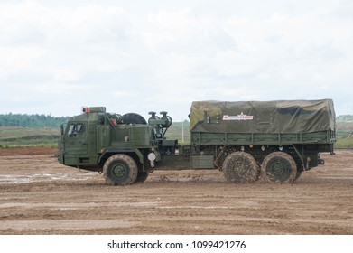 MILITARY GROUND ALABINO, MOSCOW OBLAST, RUSSIA - Aug 24, 2017: Russian military truck BAZ-6402 cross-country racing on the landfill Alabino, international military-technical forum ARMY-2017, side view