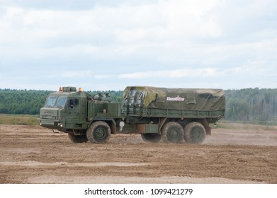MILITARY GROUND ALABINO, MOSCOW OBLAST, RUSSIA - Aug 24, 2017: Russian military truck BAZ-6402 cross-country rides at the site of Alabino, international military-technical forum ARMY-2017, side view