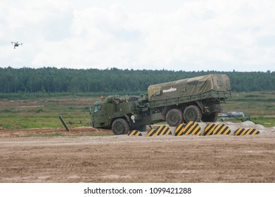 MILITARY GROUND ALABINO, MOSCOW OBLAST, RUSSIA - Aug 24, 2017: Russian military truck BAZ-6402 overcomes an obstacle at the site of Alabino, the international military forum ARMY-2017, side view