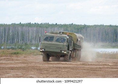 MILITARY GROUND ALABINO, MOSCOW OBLAST, RUSSIA - Aug 24, 2017: Russian military truck BAZ-6402 moving on the landfill Alabino, international military-technical forum ARMY-2017, front view