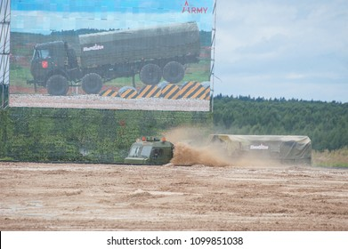 """MILITARY GROUND ALABINO, MOSCOW OBLAST, RUSSIA - Aug 24, 2017: Russian military truck BAZ-6402 """"Voschina"""" passes through the pool at the site of Alabino, the international military forum ARMY-2017"""