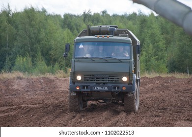 MILITARY GROUND ALABINO, MOSCOW OBLAST, RUSSIA - Aug 24, 2017: Russian military ambulance AS4350 on the basis of KAMAZ-43501 is moving off-road, front view, international military forum ARMY-2017